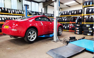 Car on Vehicle Lift at MQ Mobile Tyres Depot