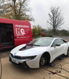 white BMW tyre fitting